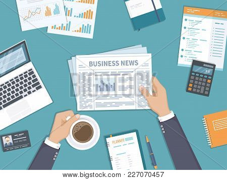 Business News. Businessman Holding A Newspaper And Coffee Cup On The Desktop. Coffee Break, Breakfas