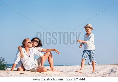 Happy Family Spent Vacation Time On The Sea Coast
