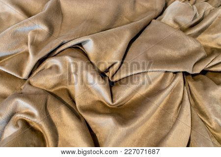 Beige Soft Blanket With Random Folds And Light And Dark Shadows.