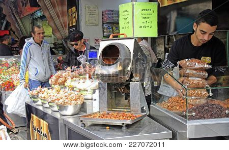 Jerusalem, Israel - December 1, 2017: Man Is Selling Sweets At Machane Yehuda Market In Jerusalem, I