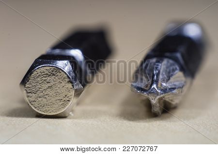 Joinery Accessories In A Large Magnification. The Screwdriver Bit Is Shown In Macro Technology.