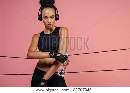 Female Taking A Break After Exercising