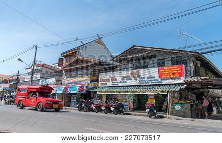 Chiang Mai Thailand - January 29 2018; Typical Thai Street Scene With Variety Of Transportation Vehi