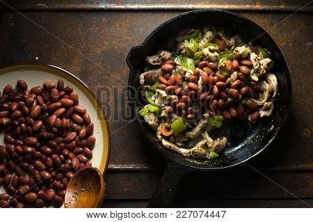 Beans Are Spread In A Frying Pan With Pepper And Chicken Horizontal