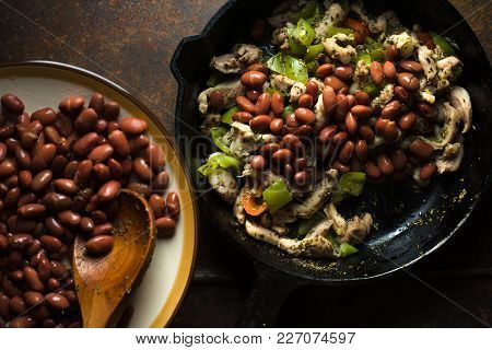Beans Are Spread In A Frying Pan With Pepper And Chicken Closeup Horizontal