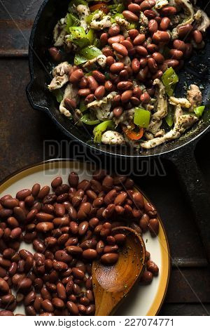 Beans Are Spread In A Frying Pan With Pepper And Chicken Top View Vertical