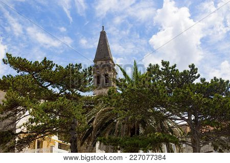 Historical Tower On A Background Of Palm Trees