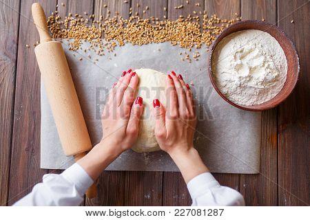 Woman's Hands Knead Dough
