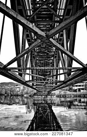 Riveted Bridge Seen From Underneath. Black And White High Contrast