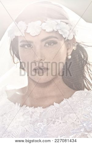 An Image Of A Very Attractive Mexican Young Woman, Dressed In A Designer Wedding Dress And With A Ve