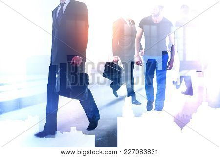 Businessmen Walking On Abstract City Office Background. Teamwork And Career Concept. Double Exposure
