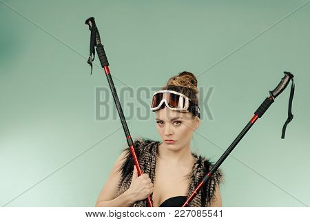Winter Sport Activity Concept. Atractive Smiling Girl Wearing Black Bra, Ski Goggles And Furry Waist