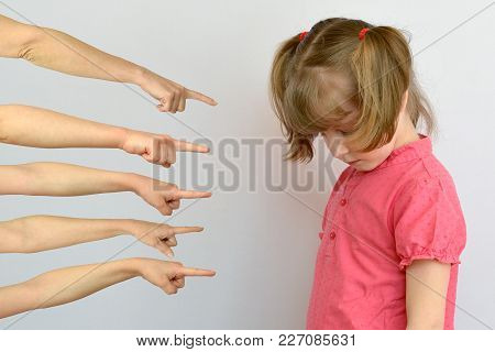 Offended Child Showing Thumbs . Conceptual Photography On A White Background.