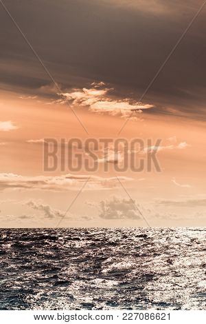Colorful Sunset Over Evening Sea Horizon, Clouds Sky. Tranquil Scene. Natural Background. Landscape.