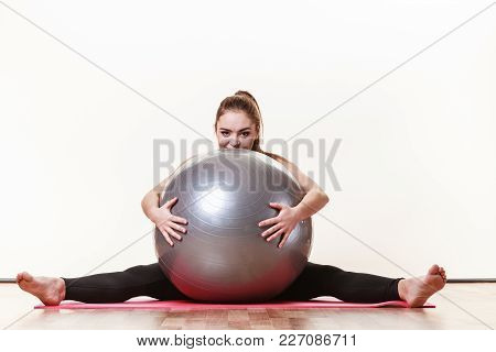 Girl With Training Equipment. Young Female In Gym With Fit Ball. Activity Fitness Health Workout Con