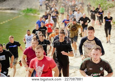 Men And Women At The Start Overcame The Watery Mud Barrier During The Race To The Legion