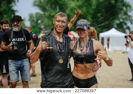 Women And Men At The Finish Celebrate The Victory During The Race To Survive On The Legion Run , Hel