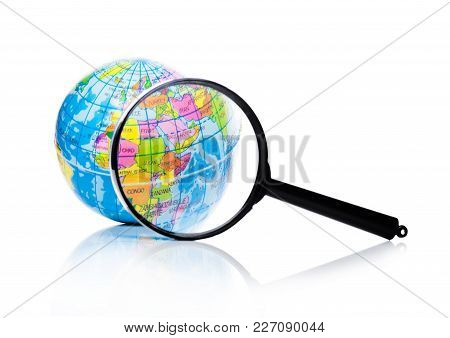 Globe Under Magnifying Glass Zooming Asia And Africa On White Background