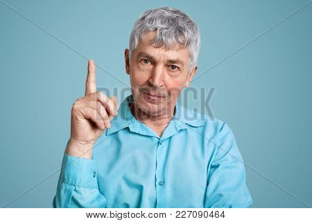 Experienced Male Pensioner In Formal Shirt Raises Fore Finger As Get Brilliant Idea For Coming Weeke