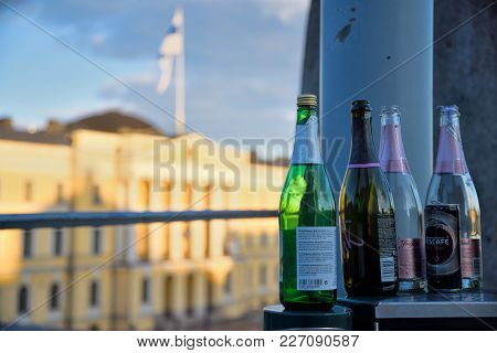 Helsinki, Finland - May 1: Empty Sparkling Wine Bottles On Top Of A Metallic Trash Bin Outdoors At T