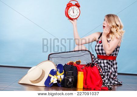 Time For Travel, Being Late Concept. Terryfied Woman Sitting On Floor With Messy Packed Suitcase Hol