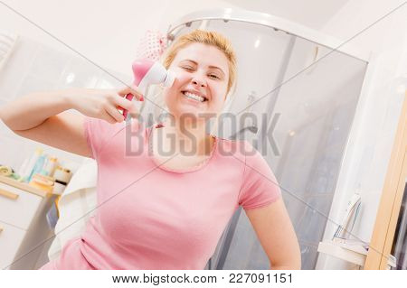 Deep Cleaning Face Tools Concept. Happy Woman Using Facial Cleansing Brush Machine.