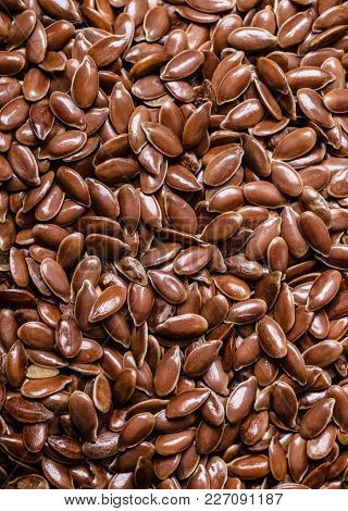 Healthy Diet Organic Nutrition. Brown Raw Flax Seeds Linseed As Texture Background