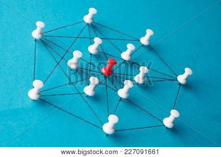 Network Connection Made From Push Pins And Thread On Blue Background, Close-up. Pin Needles Connecte