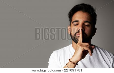 Positive Bearded Male Model And Closes Eyes Isolated Over White Background. Optimistic Male Expresse