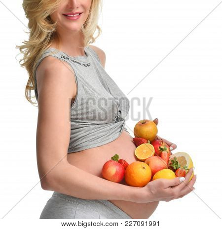 Beautiful Pregnant Woman With Fresh Fruits. Pregnancy Motherhood Expectation Healthy Eating And Weig