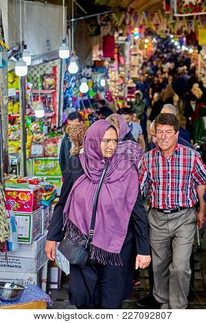 Tehran, Iran - April 29, 2017: Iranian Woman In  Religious Veil Goes To Market With Tents With Souve