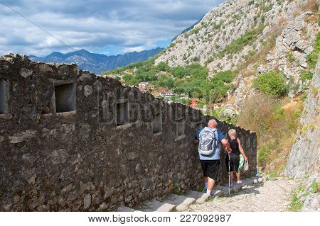 Kotor, Montenegro - October 2017: Tourists  Hiking The Trail Along The Fortification Walls In Kotor
