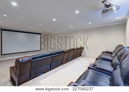 Contemporary Basement Movie Room With Black Leather Chairs