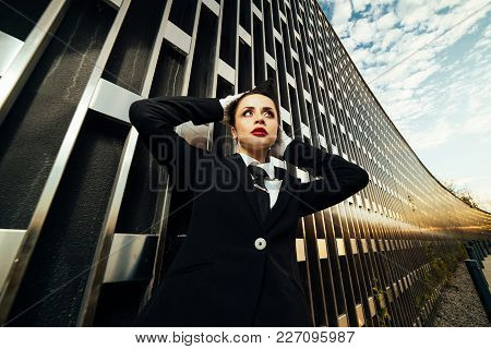 Young Beautiful Woman Stewardess In Uniform Waiting For Her Flight And Thinking About The Sky