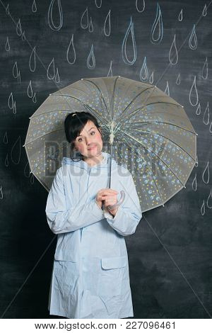 White Caucasian Woman In Raincoat Under Umbrella On Drawn By Chalk Drops Of Rain Background