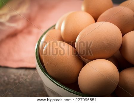 Brown Farmers Cage-free Chicken Eggs In Bowl, Close Up