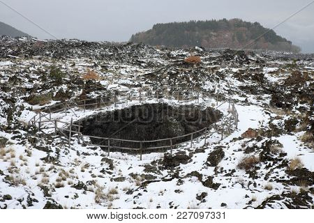 snowing on Angelo Cave, on background Egitto Mount in Etna Park, Sicily