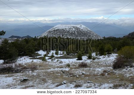 snowy Nuovo Mount volcanic crater in Etna National Park, Sicily
