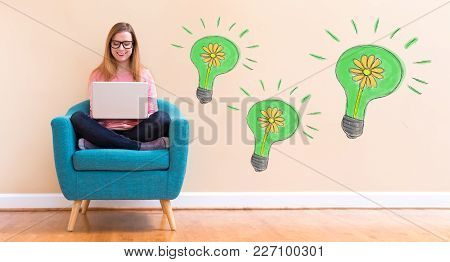 Eco Energy With Young Woman Using Her Laptop In A Chair