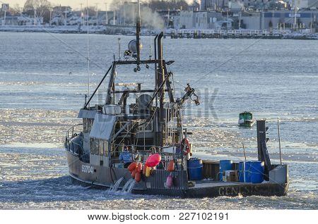 New Bedford, Massachusetts, Usa - January 9, 2018: Commercial Fishing Boat Genesis On Icy Acushnet R