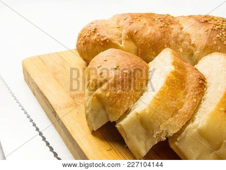 Sliced Whole Wheat Breads With A Knife On A Chopping Board