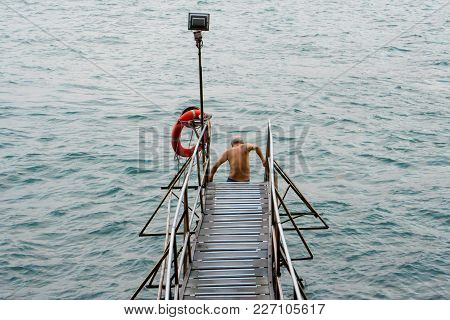 An Old Man Taking A Swim Off A Sai Wan Swimming Shed Pier