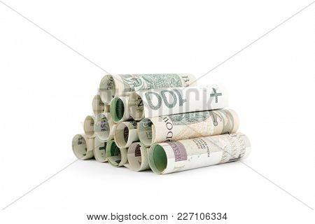 Polish banknotes rolled up isolated on white background