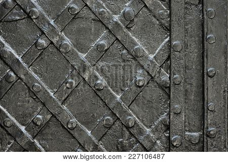 black forged iron door for texture or background, ancient architecture of castle gate backdrop