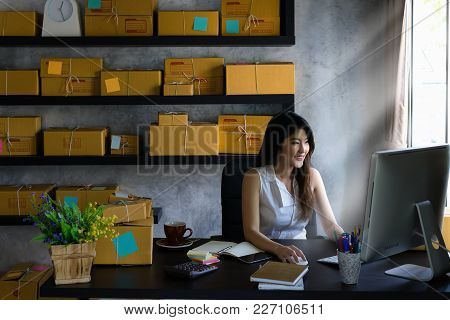 Young Asian Woman Entrepreneur, Teenager Is Work At Home Business Owner By Computer In Morning. Happ