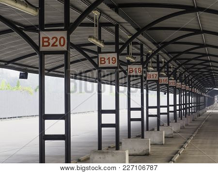 Perspective Of Outdoor Empty Parking Lot With Steel Tube Structure And Metal Sheet Roof, Number Sign