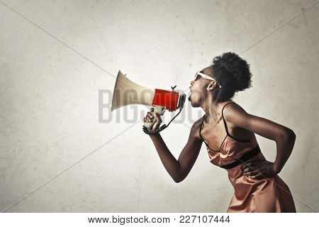 Woman screaming into the megaphone