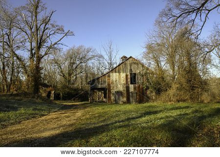 Colorful Photo Of Abandoned Barn In Warren County Missouri Just After Sunrise.