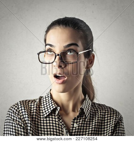 Surprised woman wearing glasses