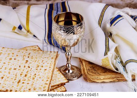 Matzo For Passover With Metal Tray And Wine On Table Close Up